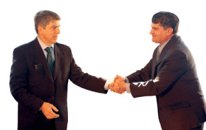 businessmen-shaking-hands-1240995-300x189